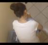 上からトイレ盗撮 洋式トイレを和式スタイルで使用する団子ヘアお姉さん