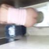 ピンクキャミお姉ちゃんの中腰放尿シーン